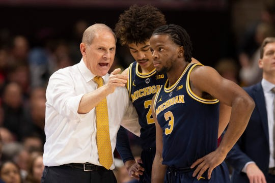 Michigan Wolverines head coach John Beilein spells with  guard Jordan Poole (2) and  guard Zavier Simpson (3) during the first half against the Maryland Terrapins at XFINITY Center.