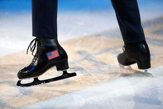 Ice skates with an American flag are shown during a skating exhibition after the U.S. Figure Skating Championships on Jan. 27, 2019.