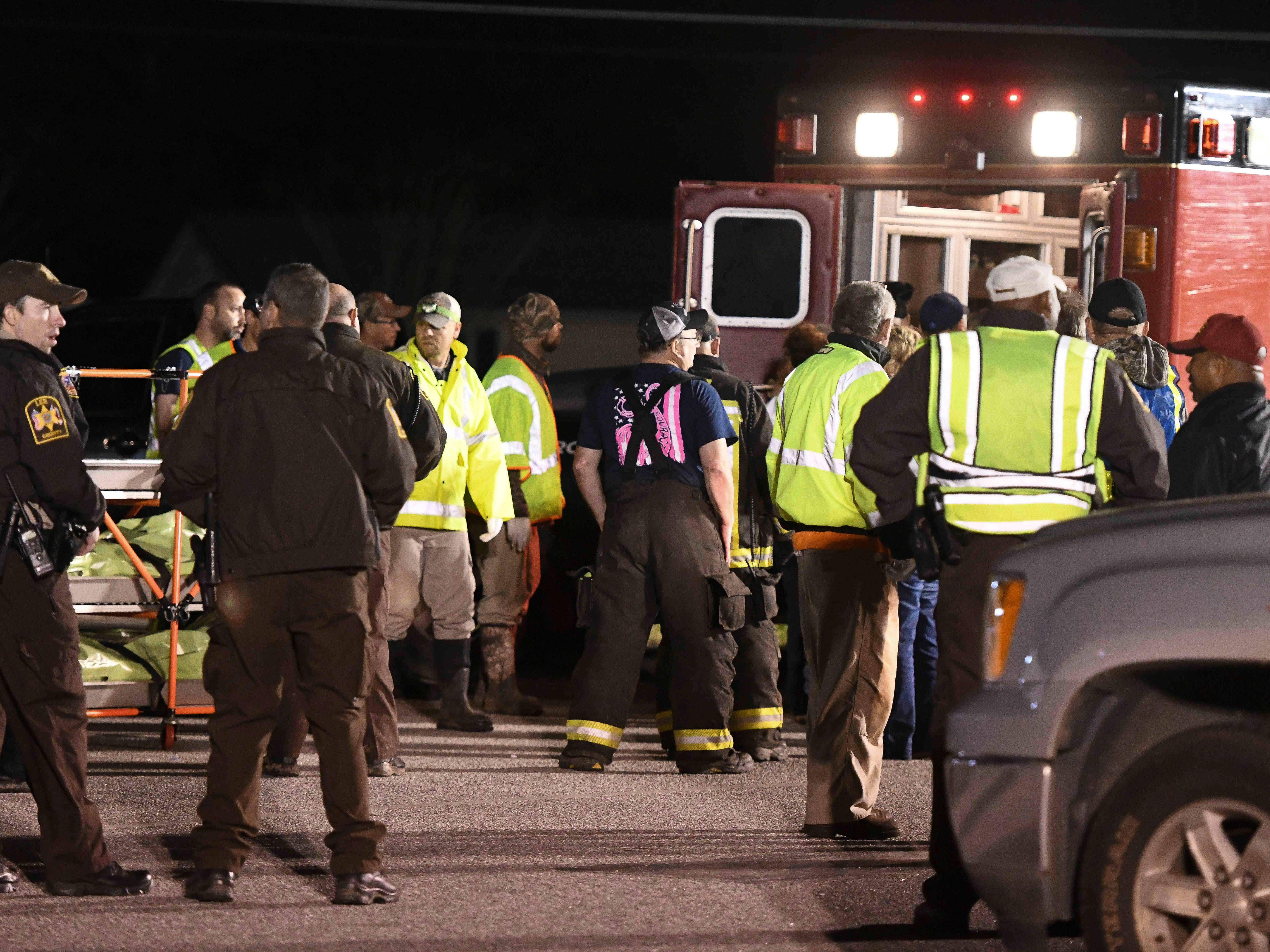 Emergency personnel work the staging area at Sanford Middle School in Beauregard, Ala., Sunday, March 3, 2019, after tornados ravaged the area, causing multiple fatalities. (AP Photo/Julie Bennett) ORG XMIT: ALJB151