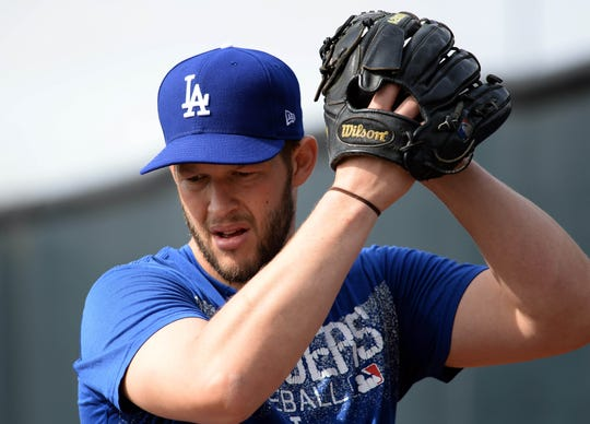 Los Angeles Dodgers pitcher Clayton Kershaw throws during a spring training workout last month.