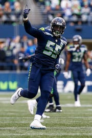 Seattle Seahawks defensive end Frank Clark (55) celebrates following a sack against the Los Angeles Chargers during the fourth quarter at CenturyLink Field.