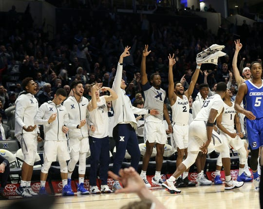 The Xavier bench reacts during the second half against the Creighton Bluejays at the Cintas Center. The Musketeers won 64-61 in overtime.