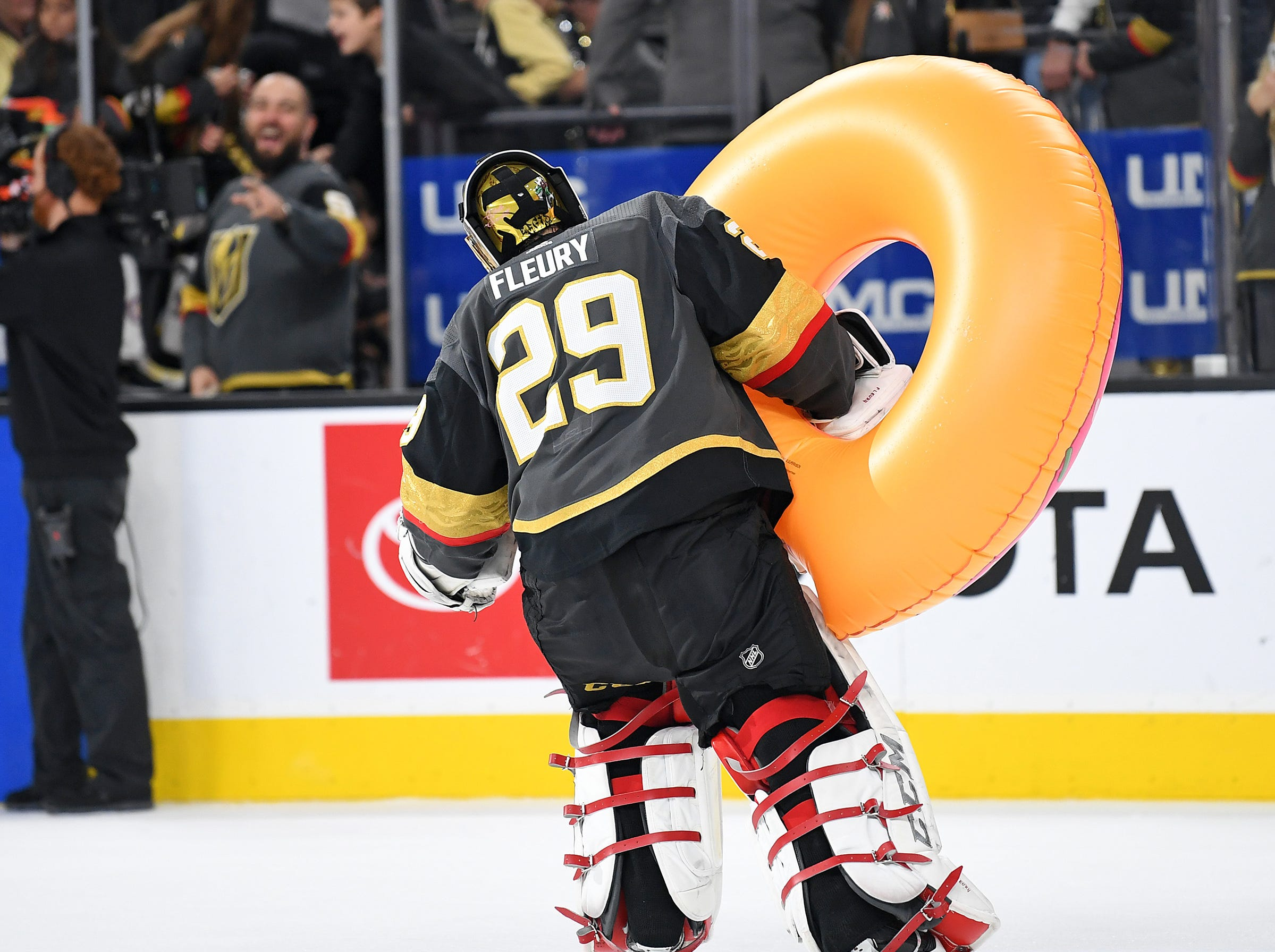 March 3: Vegas Golden Knights goaltender Marc-Andre Fleury carries an inflatable doughnut after shutting out the Vancouver Canucks 3-0 at T-Mobile Arena.
