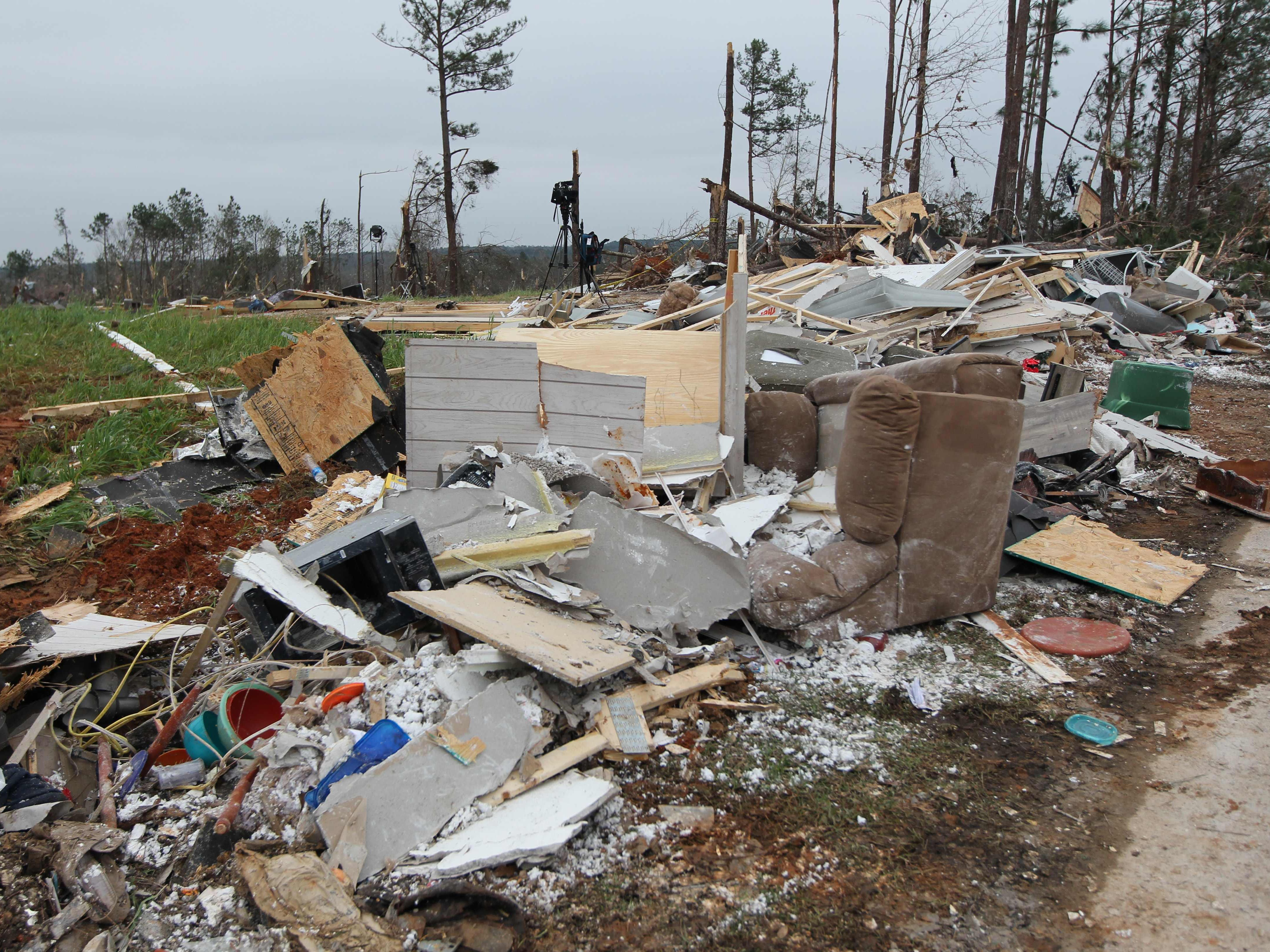 """Damage is seen from a tornado which killed at least 23 people in Beauregard, Alabama on March 4, 2019. - Rescuers in Alabama were set to resume search operations Monday after at least two tornadoes killed 23 people, uprooted trees and caused """"catastrophic"""" damage to buildings and roads in the southern US state.""""The devastation is incredible,"""" Lee County Sheriff Jay Jones told the local CBS affiliate late Sunday.""""I cannot recall at least in the last 50 years... a situation where we have had this loss of life that we experienced today."""" (Photo by Tami Chappell / AFP)TAMI CHAPPELL/AFP/Getty Images ORIG FILE ID: AFP_1E73RE"""