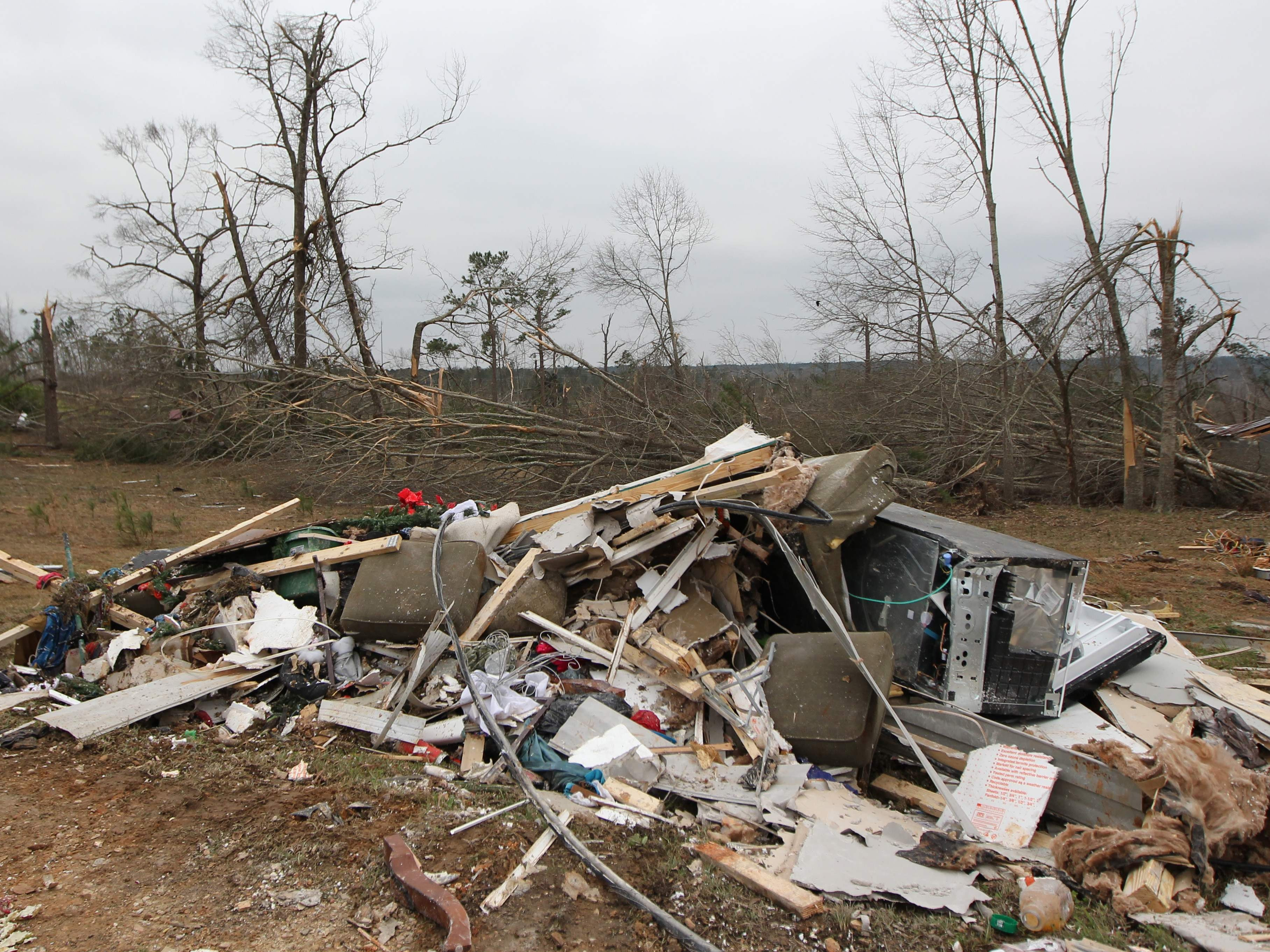 """Damage is seen from a tornado which killed at least 23 people in Beauregard, Alabama on March 4, 2019. - Rescuers in Alabama were set to resume search operations Monday after at least two tornadoes killed 23 people, uprooted trees and caused """"catastrophic"""" damage to buildings and roads in the southern US state.""""The devastation is incredible,"""" Lee County Sheriff Jay Jones told the local CBS affiliate late Sunday.""""I cannot recall at least in the last 50 years... a situation where we have had this loss of life that we experienced today."""" (Photo by Tami Chappell / AFP)TAMI CHAPPELL/AFP/Getty Images ORIG FILE ID: AFP_1E73RI"""