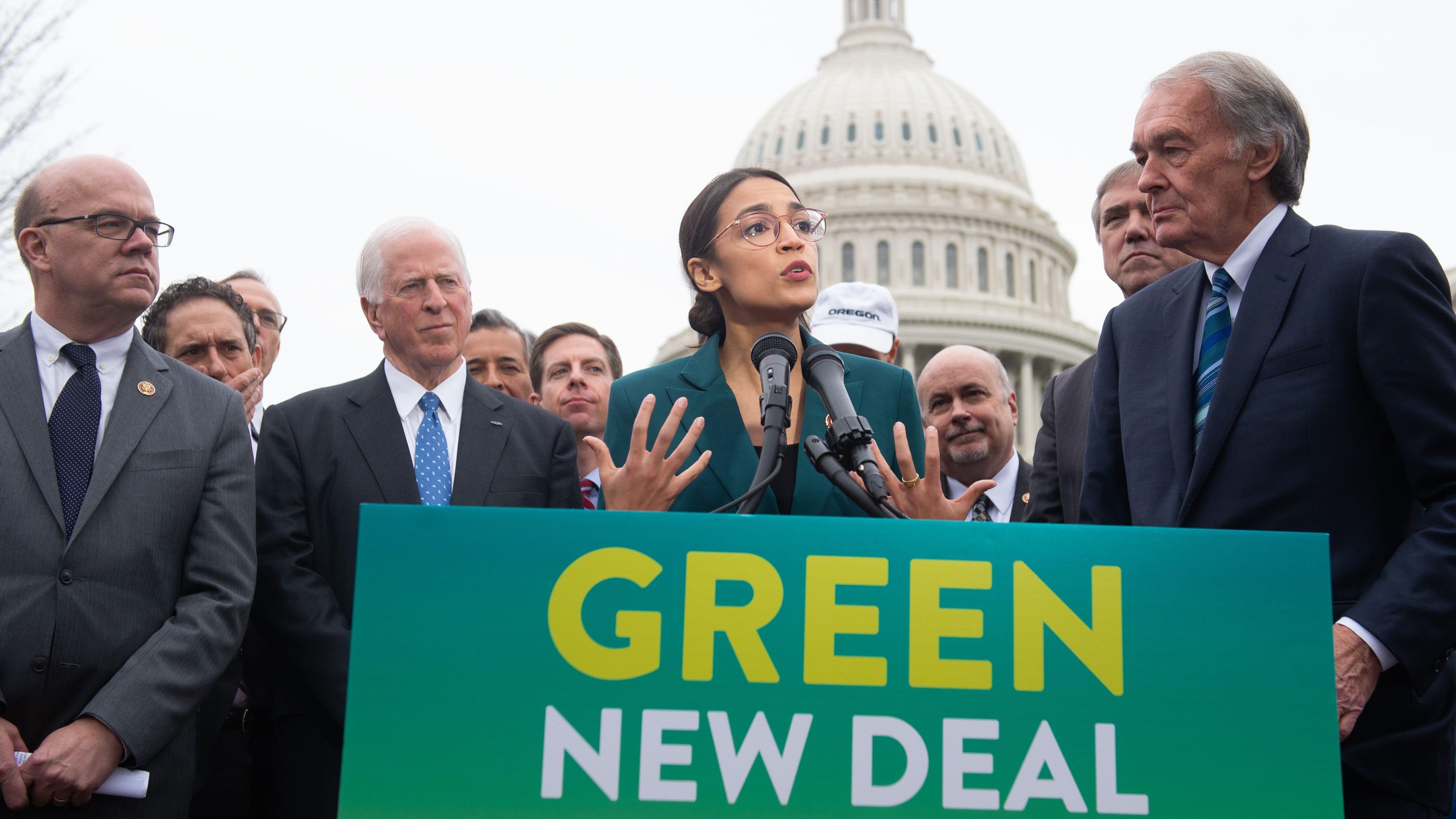 Democratic Rep. Alexandria Ocasio-Cortez of New York and Sen. Ed Markey of Massachusetts, right, announce the Green New Deal legislation on Feb. 7, 2019.