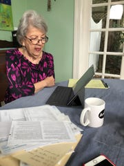 Odette Blelloch using her iPad Pro and the TurboTax web site to prepare her taxes.