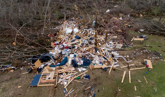 Debris litters a yard the day after a deadly tornado damaged a home in Beauregard, Alabama.