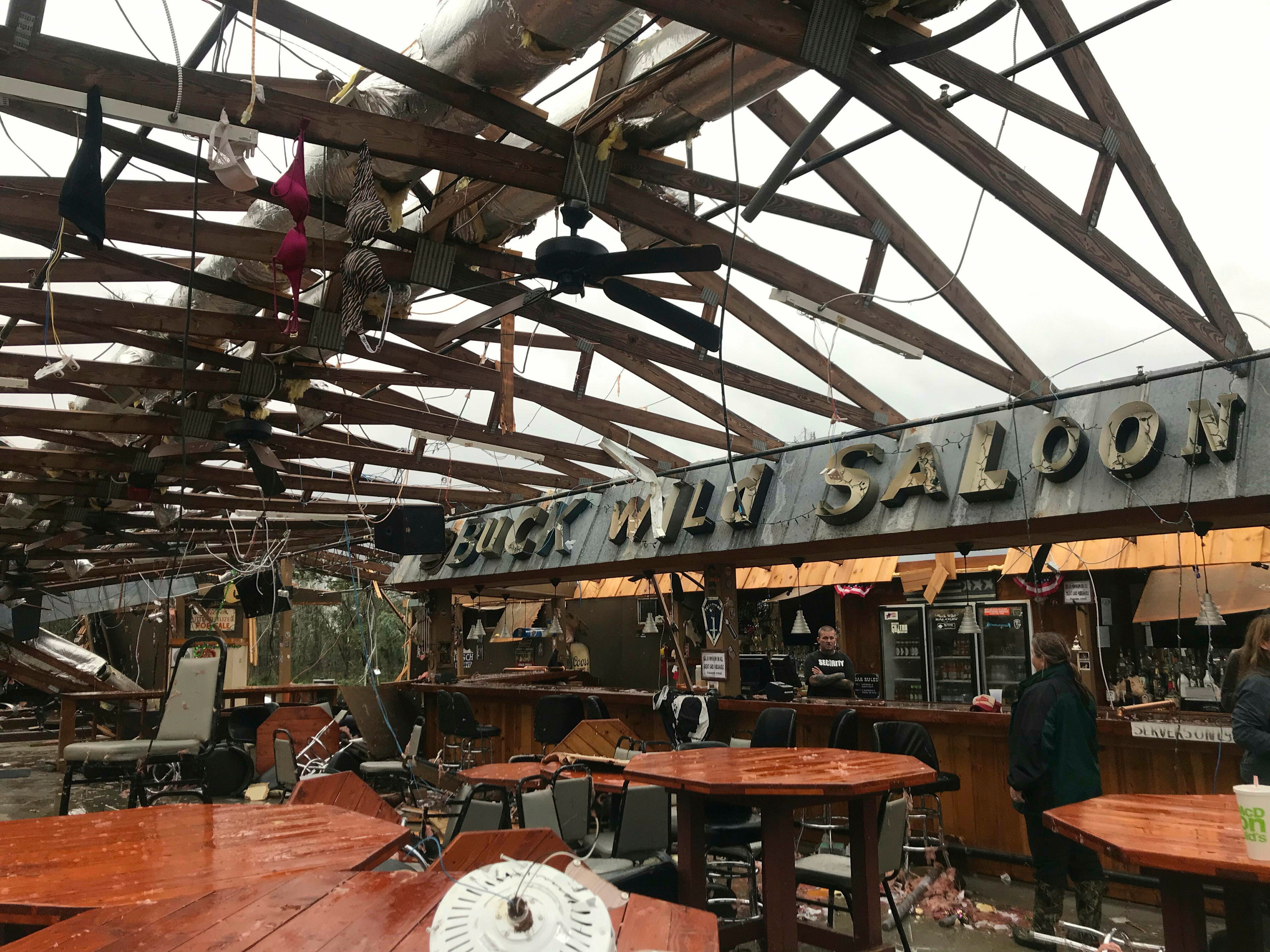 This photo shows some damage at the Buck Wild Saloon, located on U.S. Highway 280, east of Smiths Station, Ala., Sunday, March 3, 2019, after a powerful storm system passed through the area. (Kara Coleman Fields/Opelika-Auburn News via AP) ORG XMIT: ALOPEI35