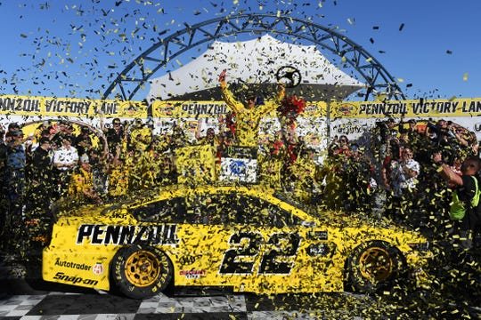 Joey Logano celebrates on his No. 22 Pennzoil Ford after winning the Pennzoil 400 at Las Vegas Motor Speedway.
