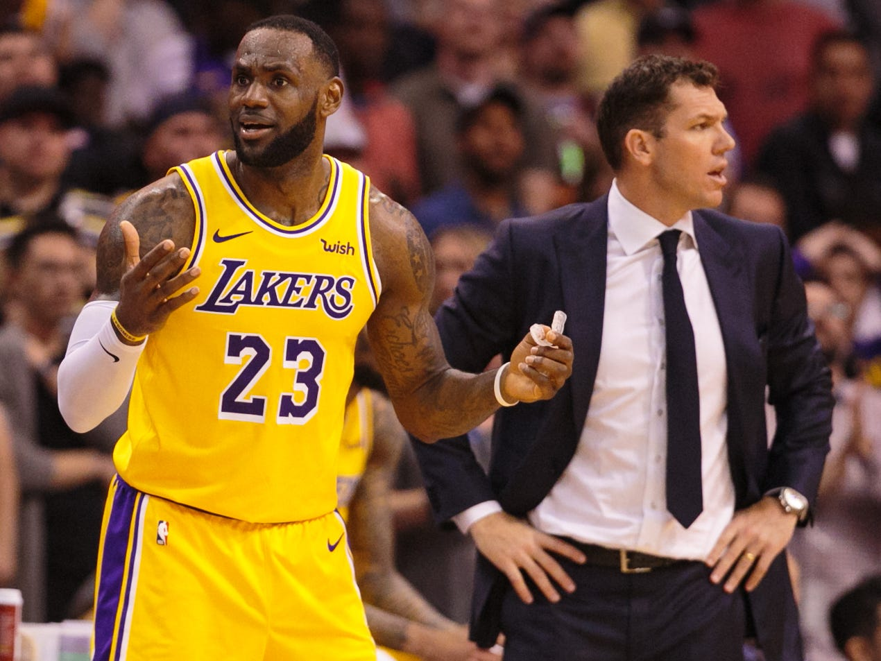 March 2, 2019: LeBron James and Lakers coach Luke Walton look to the officials for answers after a call during the fourth quarter against the Suns in Phoenix.