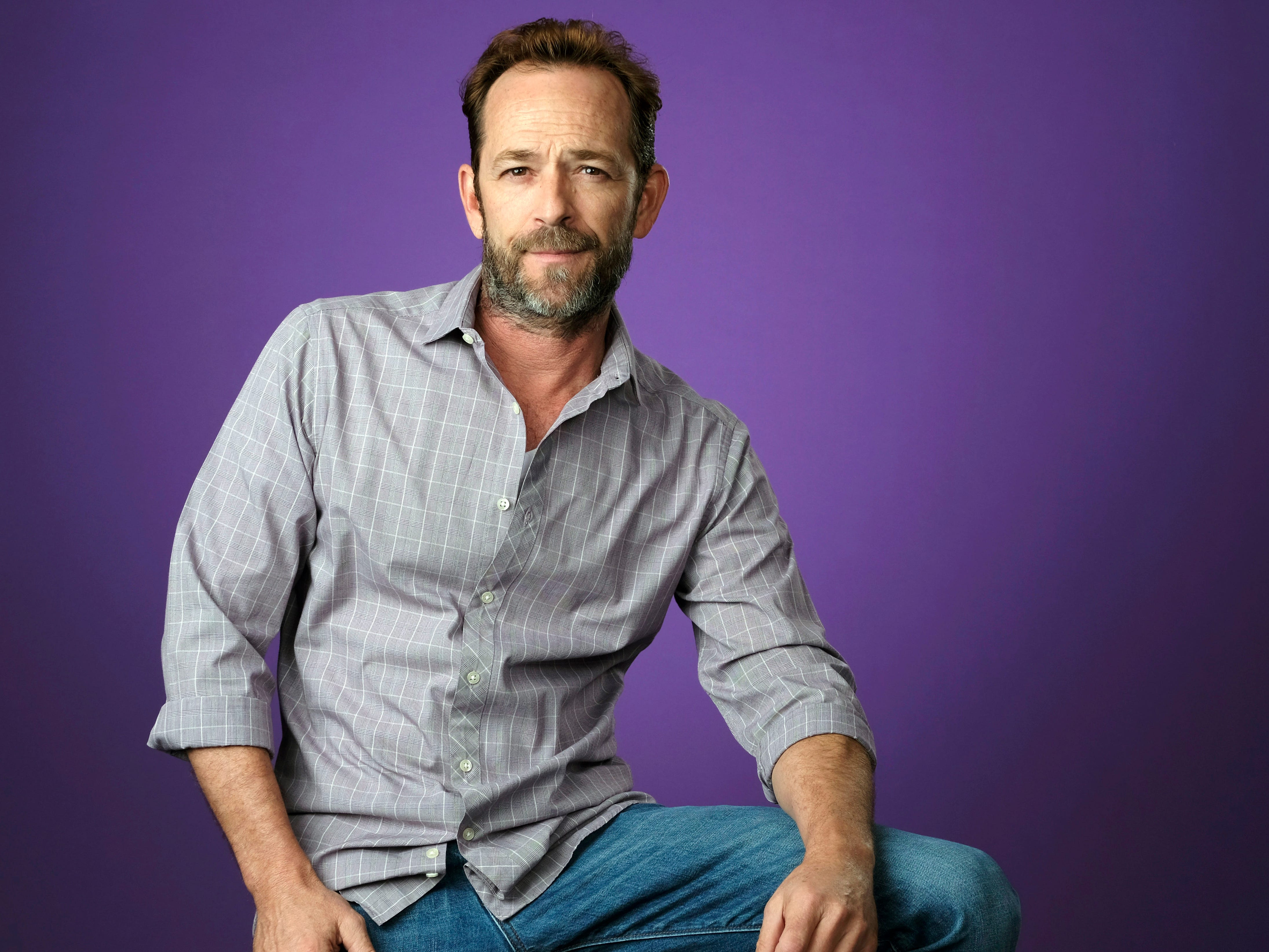 "FILE - In this Aug. 6, 2018, file photo, Luke Perry poses for a portrait during the 2018 Television Critics Association Summer Press Tour in Beverly Hills, Calif. A publicist for Perry says the ""Riverdale"" and ""Beverly Hills, 90210"" star has died. He was 52. Publicist Arnold Robinson said that Perry died Monday, March 4, 2019, after suffering a massive stroke. (Photo by Chris Pizzello/Invision/AP, File) ORG XMIT: NYCD901"