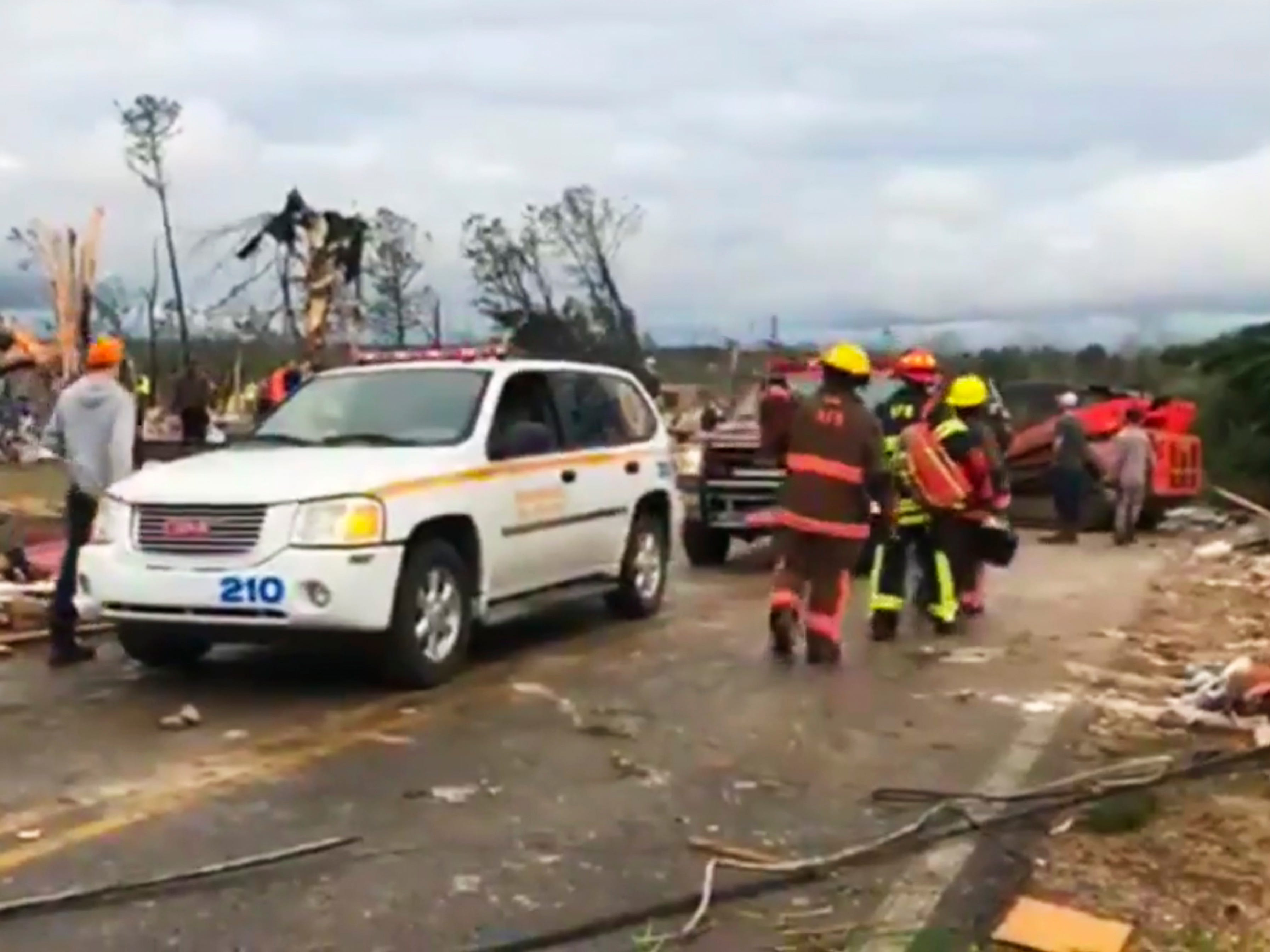 Emergency responders work in the scene amid debris in Lee County, Ala., after what appeared to be a tornado struck in the area Sunday, March 3, 2019. Severe storms destroyed mobile homes, snapped trees and left a trail of destruction amid weather warnings extending into Georgia, Florida and South Carolina, authorities said. (WKRG-TV via AP) ORG XMIT: WKRG702
