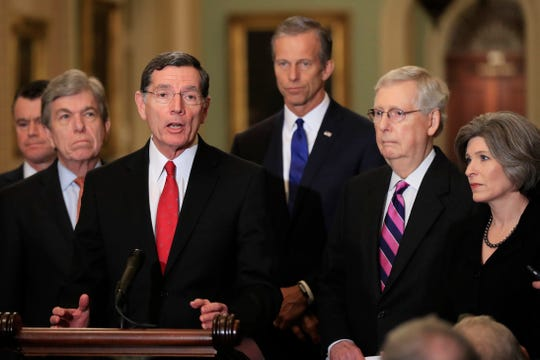 Sen. John Barrasso, center, is chairman of the Committee on Environment and Public Works.
