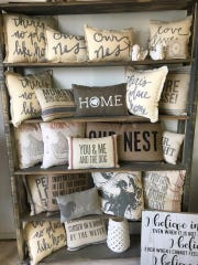 Inventory changes weekly, but inside Renu by Alice are furniture pieces, as well as smaller items, like signs and pillows with positive, inspirational phrases.