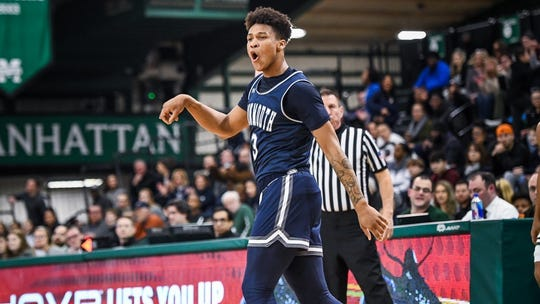 Monmouth's Deion Hammond celebrates during the Hawks regular season-ending win at Manhattan last Friday.