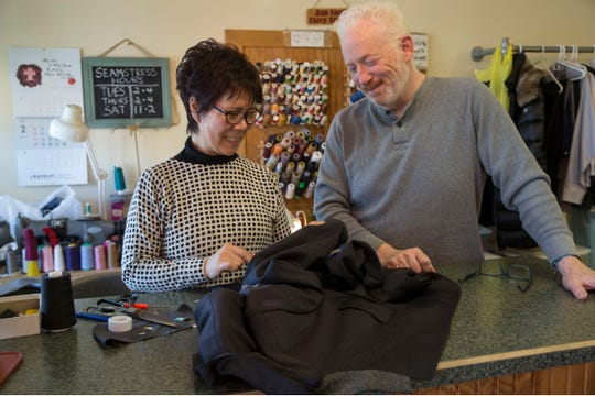 Bright Star Cleaners, is a Tinton Falls-based business that cleans clothes owned by Brian Murphy. Murphy and Kim Glosson, left, look over an alteration to a suit jacket.