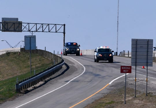 Police cars come over the Pine Street overpass on Interstate 20 as they escort a vehicle carrying the body of slain Midland police officer Nathan Heidelberg Tuesday.