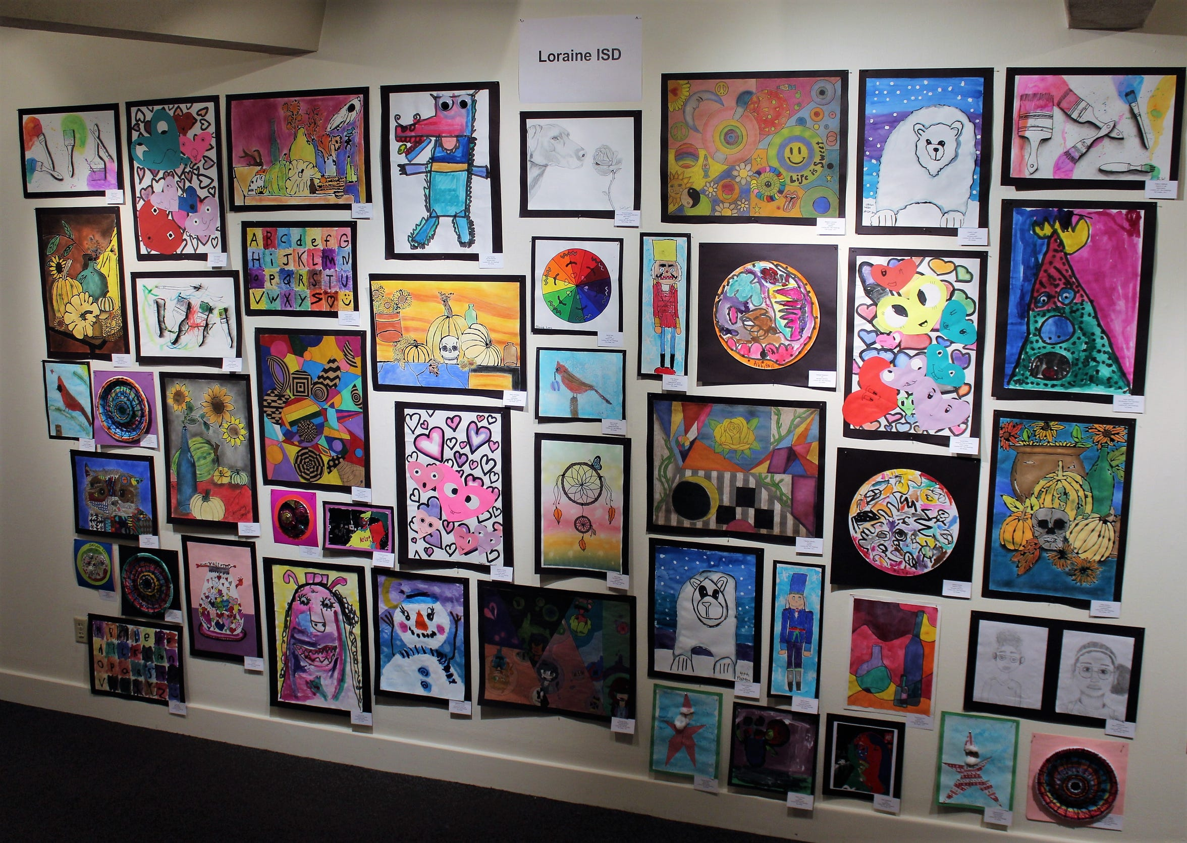 Artwork from the Loraine ISD fills a wall in the second floor gallery at The Grace Museum in Abilene.