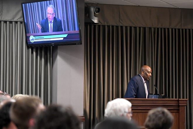 Buncombe County Sheriff Quentin Miller listens to a question from Board of Commissioners Chairman Brownie Newman during a March 5, 2019 presentation for possible additional law enforcement funding.