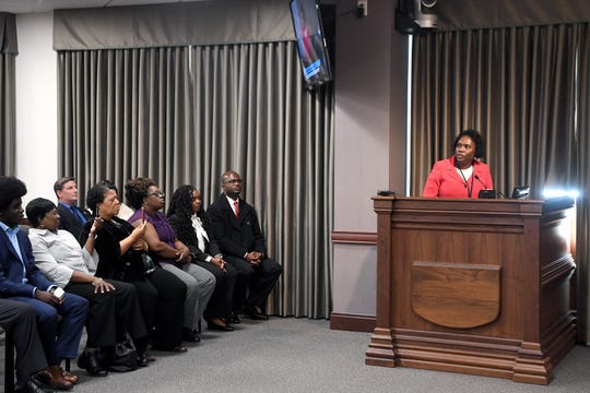 Avril Pinder addresses the crowd after her official swearing-in as the new Buncombe County manager on March 5, 2019. In her speech she said she hopes to repair the county's trust of the commission.