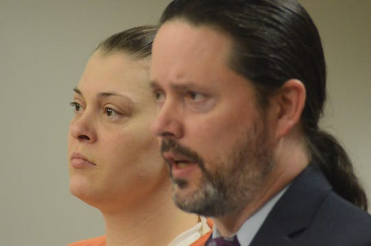 Talia Furman listens as her attorney, Justin McCarthy, speaks during the hearing Tuesday.