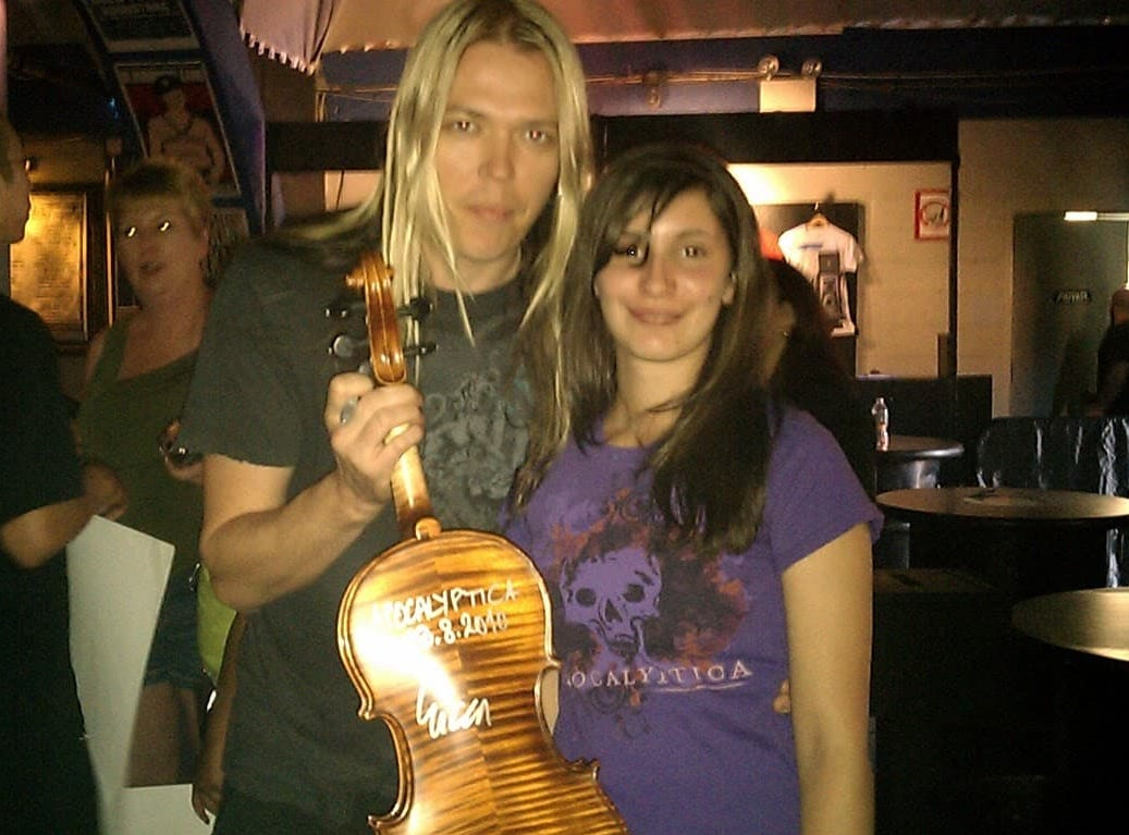Julia with Eicca Toppinnen of the Finnish cello metal band, Apocalyptica. Julia had her viola signed by the band's members.