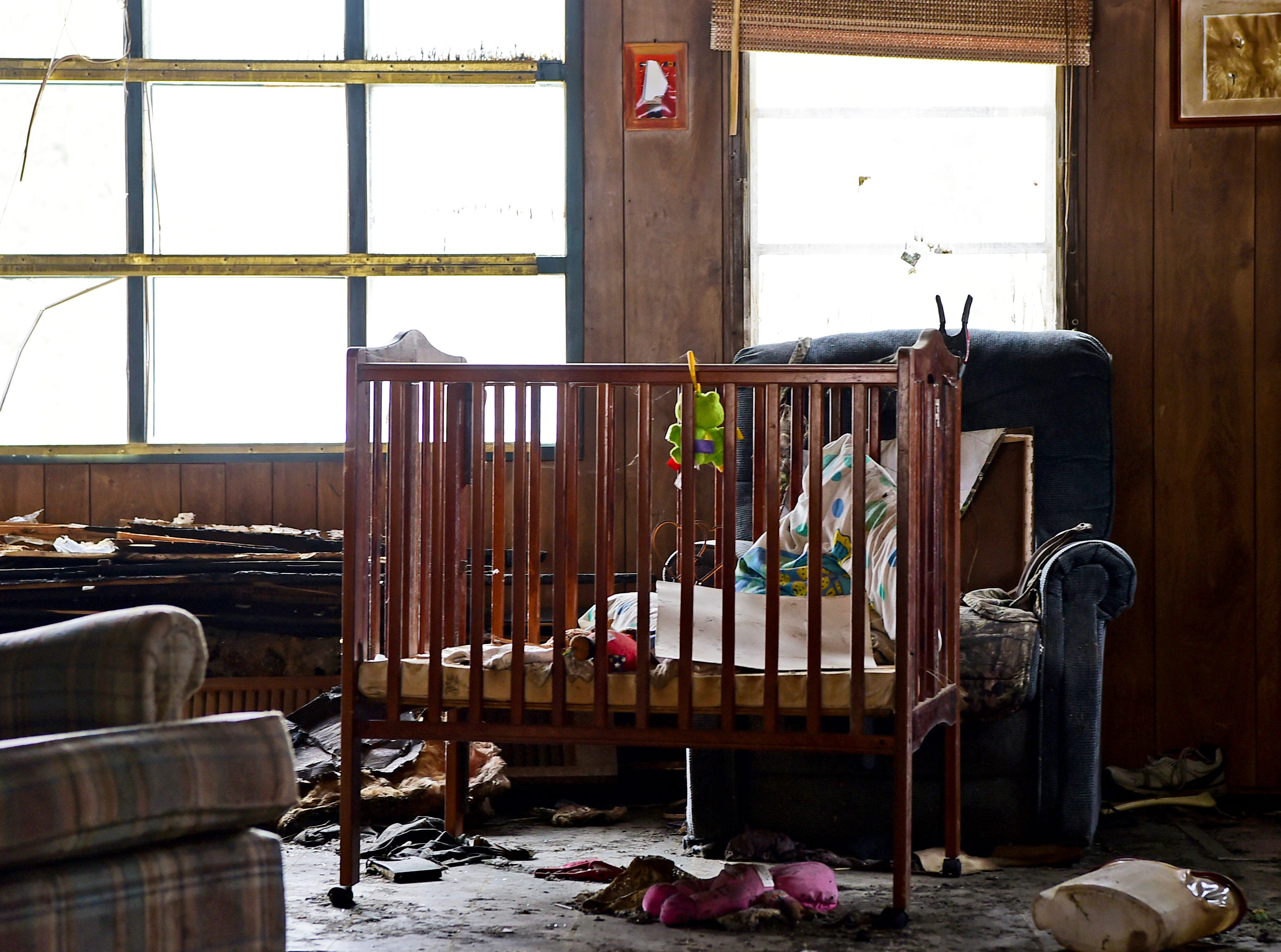 The interior of the former Card family home on Swan Road in Whitney Point still contains toys and other personal belongings. The house was destroyed by fire in 2017.  March 5, 2019.