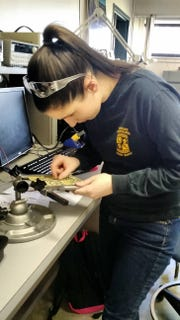 Julia working in the electronics lab at Northampton Community College.