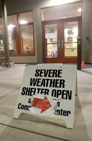 A sign directs guests to the severe weather shelter at the Kingston Village Green Community Center on Monday, March 4, 2019.