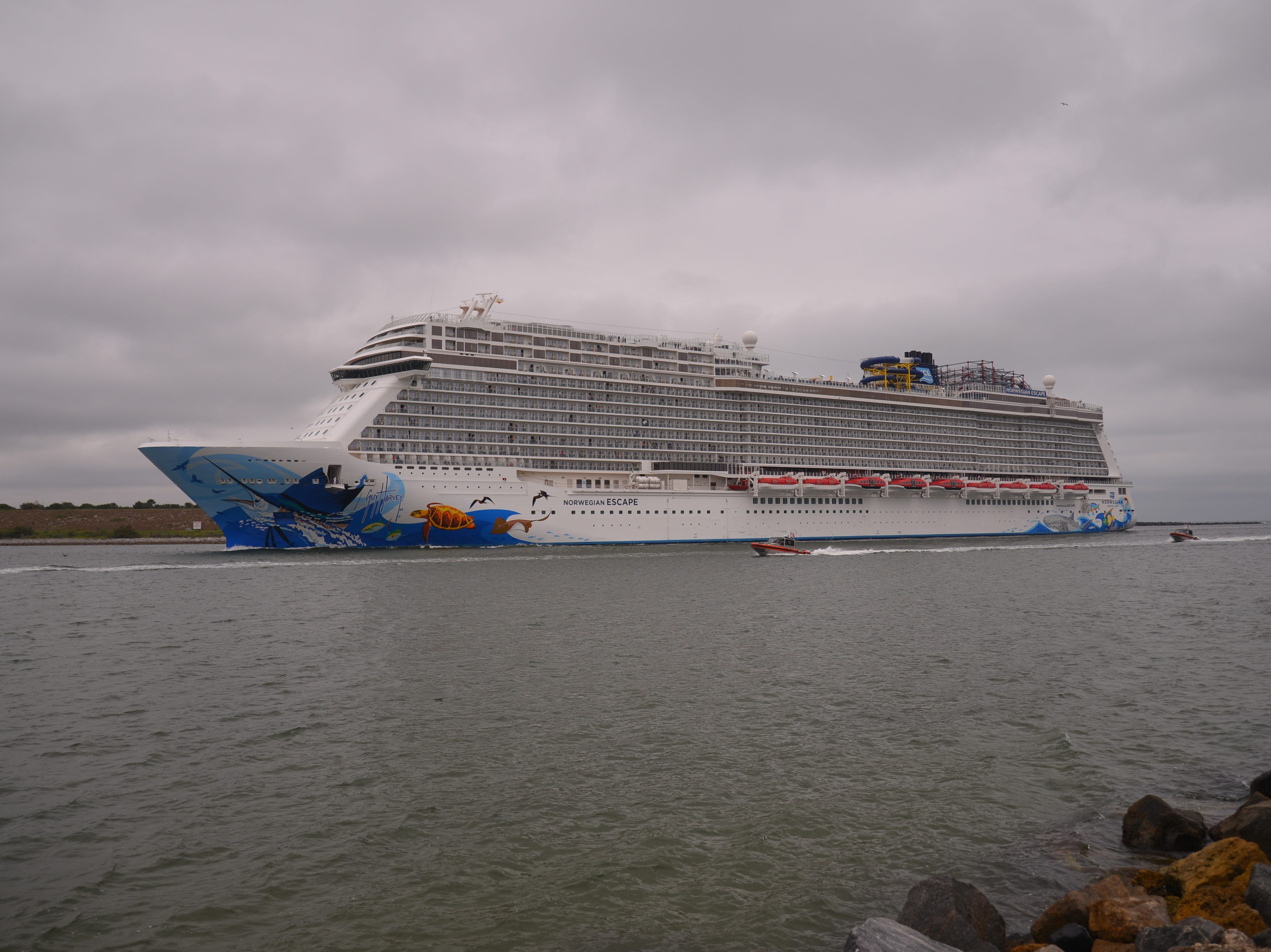 """Several passengers aboard the Norwegian Escape cruise ship were injured Sunday when what cruise officials described as a """"sudden, extreme gust of wind"""" caused the ship to suddenly list. The ship docked about 11:30 a.m. at Terminal 10 on the north side of Port Canaveral, and Brevard County Fire Rescue ambulances lined up by the ship to take injured passengers to local hospitals. In a series of tweets, Norwegian cruise officials said the 20-deck ship suddenly tilted just before midnight Sunday under the force of an unexpected gale topping 100 knots, or about 115 mph."""