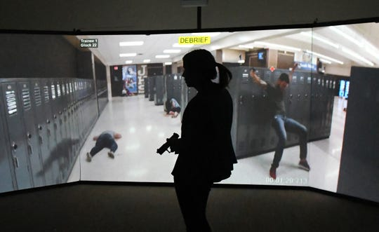 FLORIDA TODAY reporter Caroline Glenn tried the simulation, and shot the virtual school shooter, seen at right, a fraction of a second after he appeared during a school guardian training simulator session. The MILO Range 300 Theater, a high-tech interactive training system, is set up at a Brevard County Sheriff's Office facility in Sharpes, part of a program to help train school guardians.