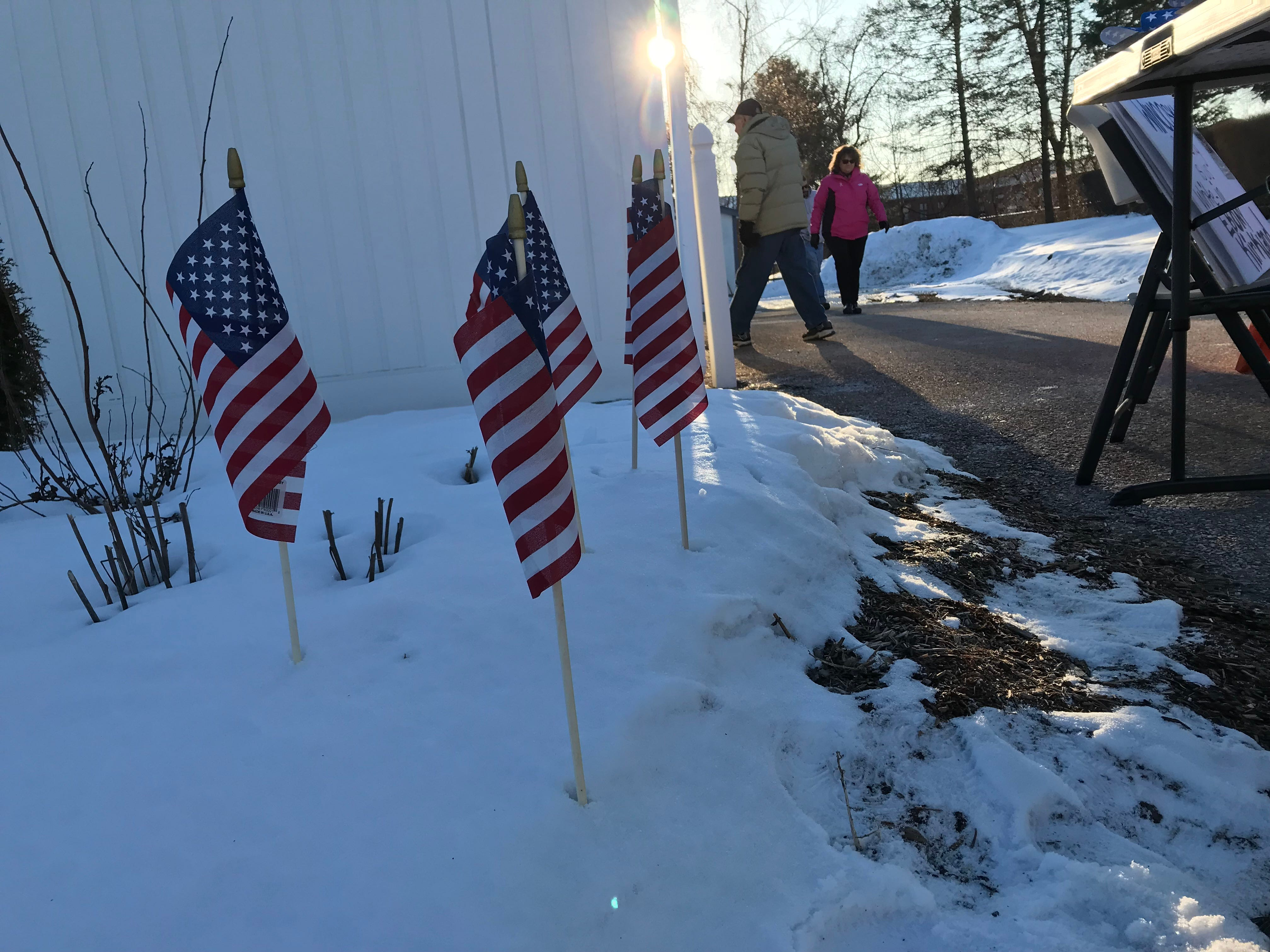 American flags were planted in snow outside of the Winooski Senior Center on Town Meeting Day, March 5, 2019.