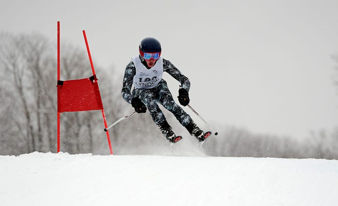 Burr and Burton's Noah Coppola competes in the Vermont boys' giant slalom championship at Burke Mountain on Monday, March 4, 2019.