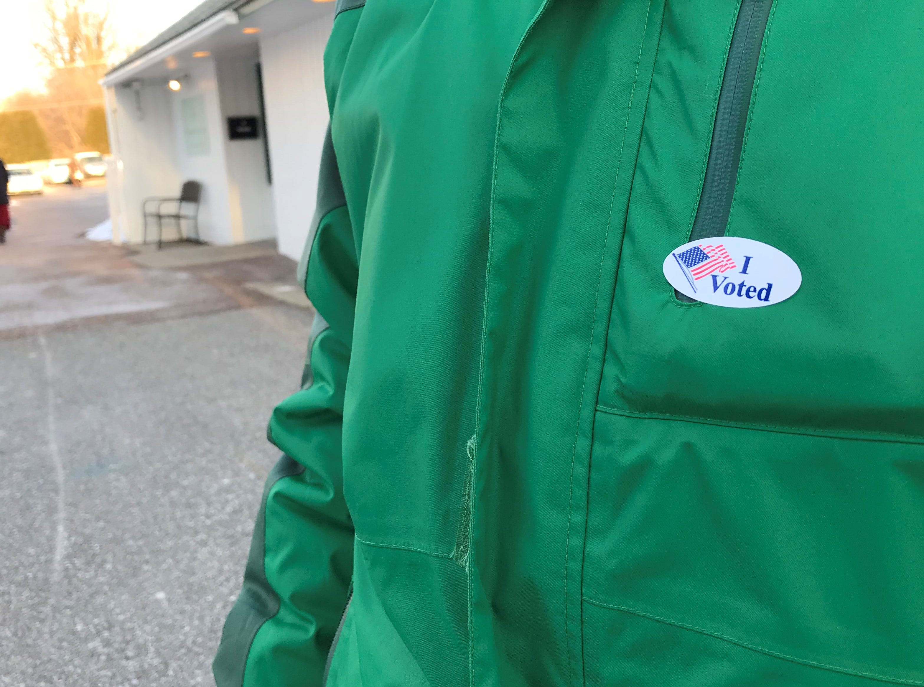 """Alana Shaw put her """"I voted"""" sticker on after stepping out of the polls at the Winooski Senior Center on Town Meeting Day, March 5, 2019."""