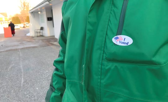 "Alana Shaw put her ""I voted"" sticker on after stepping out of the polls at the Winooski Senior Center on Town Meeting Day, March 5, 2019."
