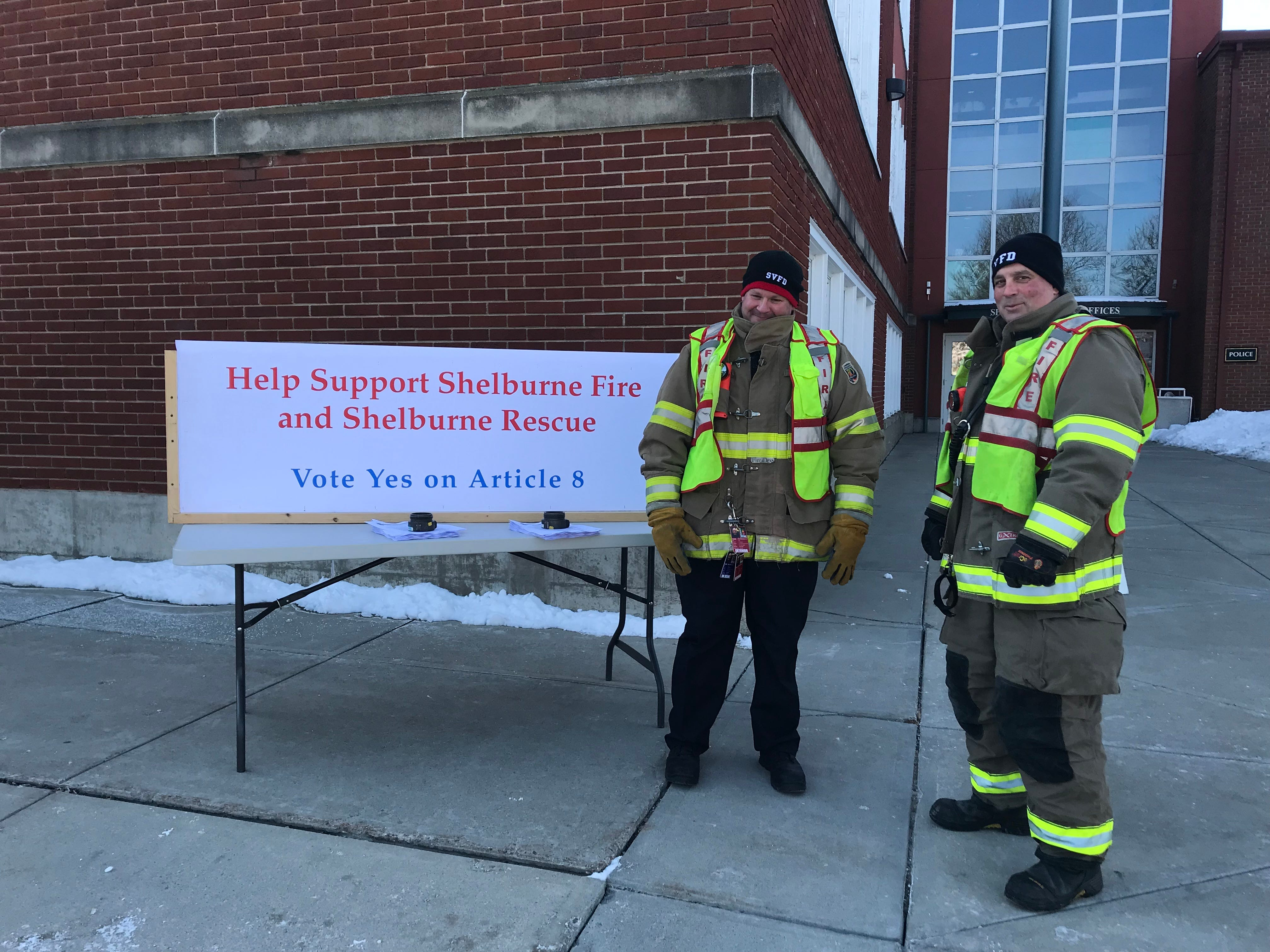 Allan Manniere and Dwight Mazur, volunteer fire fighters in Shelburne, stood on March 5, 2019, in freezing temperatures at the beginning of Town Meeting Day in Shelburne hoping to inform voters about Article 8, which asks the town to set aside funds which would allow for the possible purchase of land for a fire house on U.S. 7.