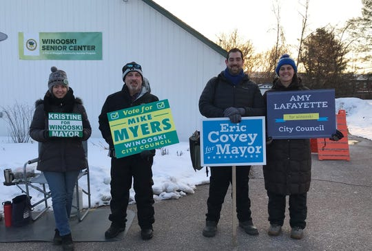 Kristine Lott, Mike Myers, Eric Covey and Amy Lafayette stand outside the Winooski Senior Center a few minutes before the polls open on Town Meeting Day, March 5, 2019.