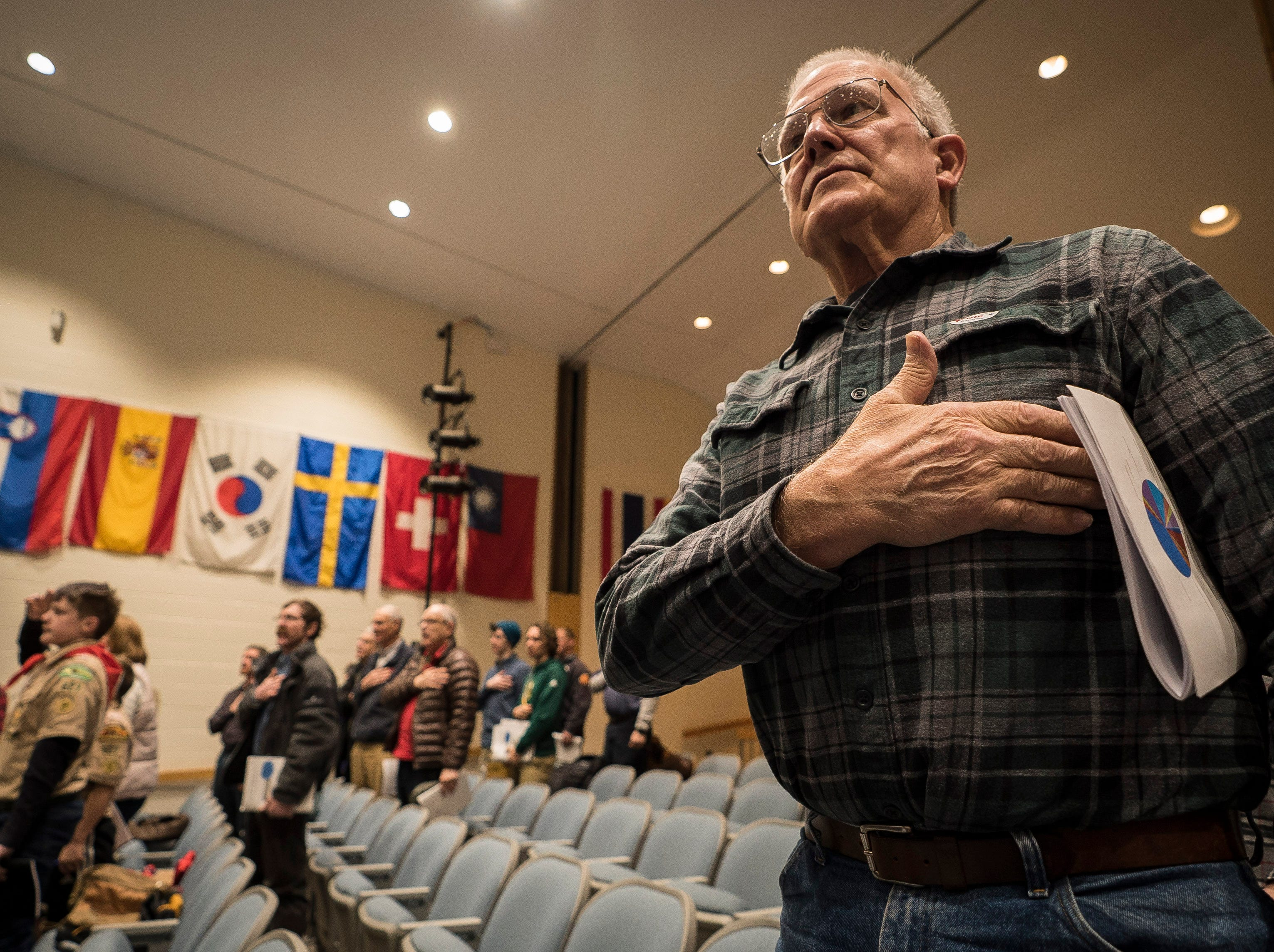 Jericho resident Ned Dubois participates in the pledge of allegiance at the start of Town Meeting Day on Tuesday, March 5, 2019, at Mount Mansfield High School.