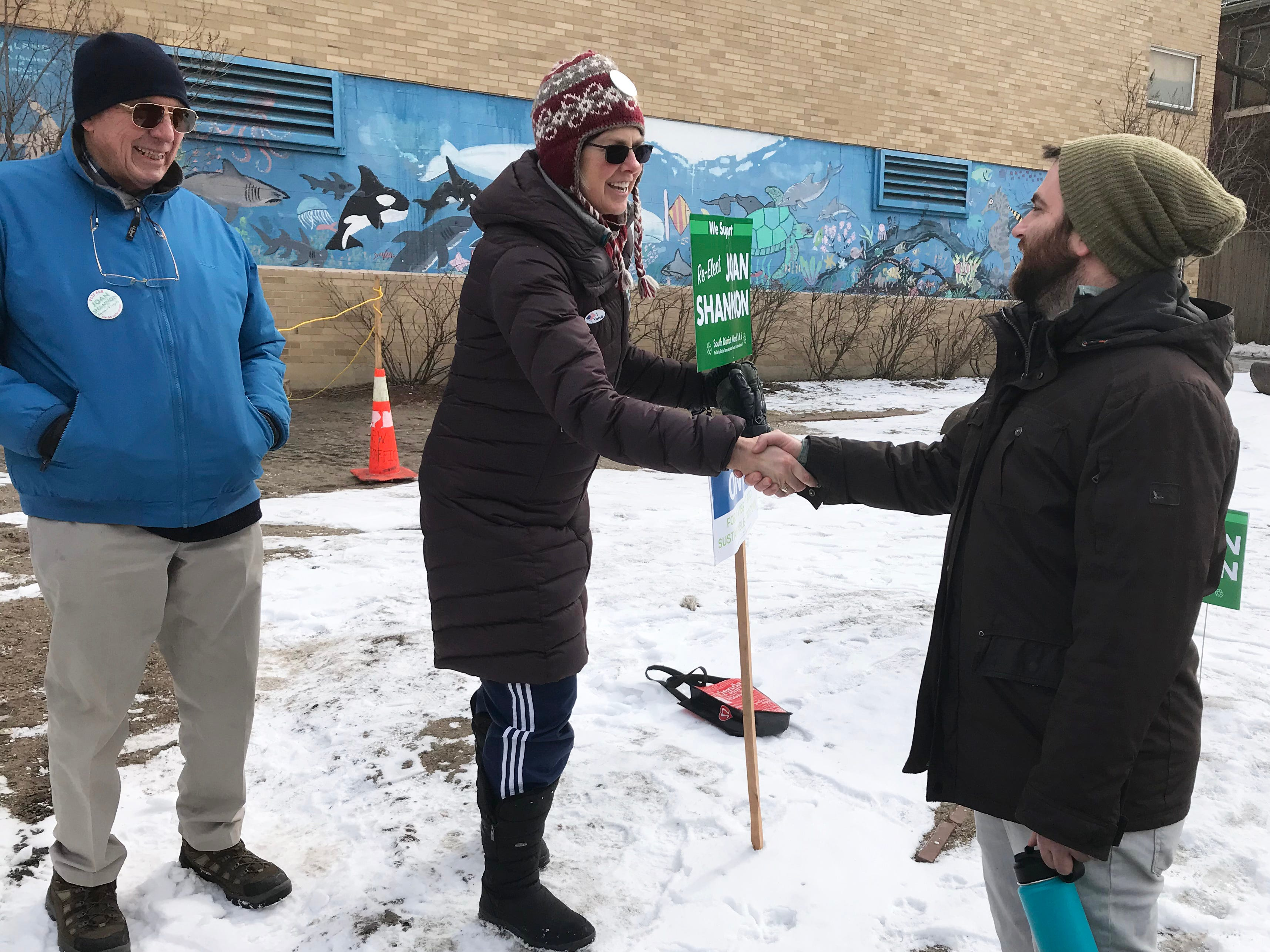 Joan Shannon, center, the incumbent candidate for Burlington CIty Council, South District, greets resident Kasey Child outside Edmunds Middle School on March 5, 2019. Pat Robbins, at left, joined Shannon at the polls.