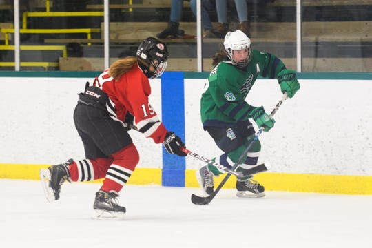 Elise Scorsome (26) skates past Rutland's Isabel Crossman (19) with the puck during the girls hockey game between the Rutland Raiders and the Burlington/Colchester Sea Lakers at the Gordon Paquette Arena at Leddy Park on Tuesday afternoon March 5, 2019 in Burlington, Vermont.