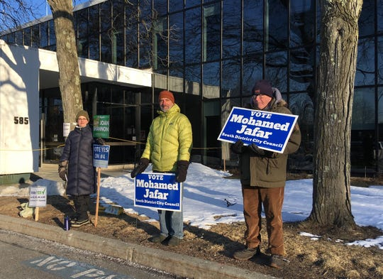 From left, Olivia LaVecchia, Andy Simon, and Jay Vos, all Ward 5 residents, stand outside the ward's polling station at Burlington Electric Department on Town Meeting Day on Tuesday, March 5, 2019.