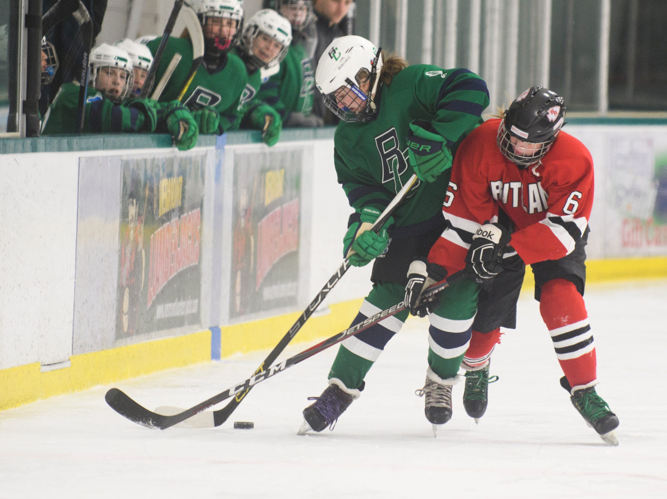Rutland's Brianna Beauchamp (6) battles for the puck with Burlington/Colchester's McKenna Weston (13) during the girls hockey game between the Rutland Raiders and the Burlington/Colchester Sea Lakers at the Gordon Paquette Arena at Leddy Park on Tuesday afternoon March 5, 2019 in Burlington, Vermont.
