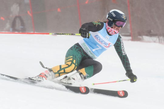 University of Vermont alpine skier Paula Moltzan makes a turn in a race for the Catamounts. The junior has been splitting her time racing the college and World Cup circuits this winter.