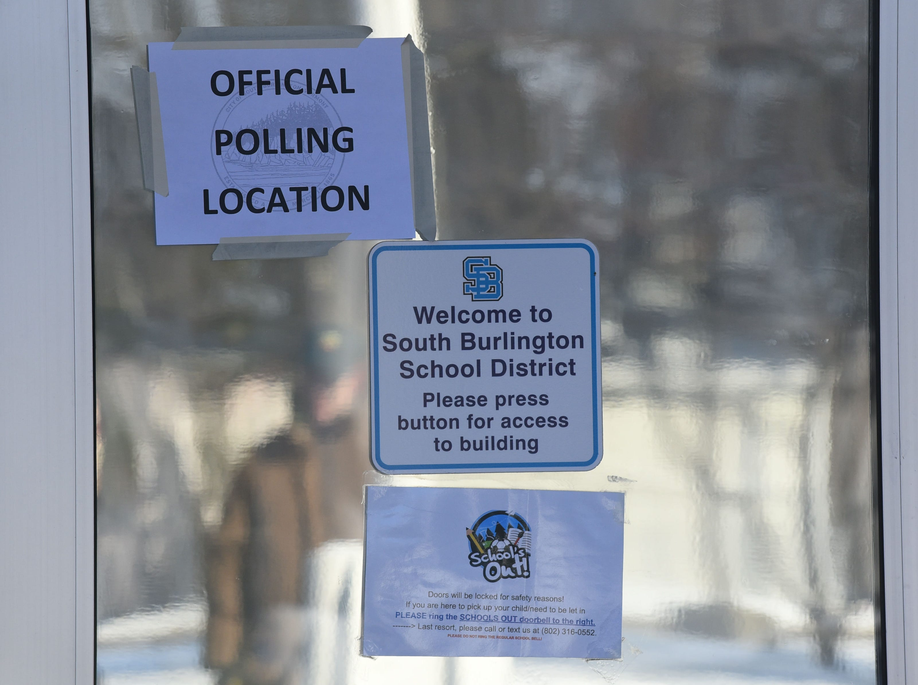 A sign on the front door of Orchard School in South Burlington identifies the school as a voting location on Town Meeting Day, Tuesday, March 5, 2019.