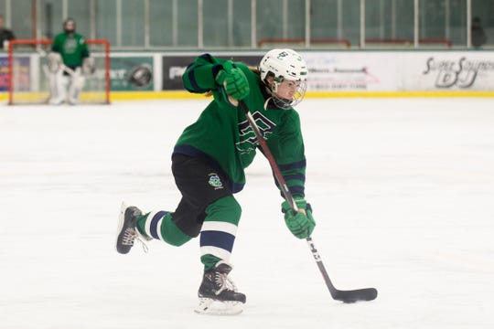 Burlington/Colchester's Madison Chagnon (4) shoots the puck during the girls hockey game between the Rutland Raiders and the Burlington/Colchester Sea Lakers at the Gordon Paquette Arena at Leddy Park on Tuesday afternoon March 5, 2019 in Burlington, Vermont.