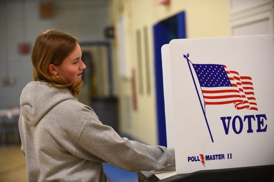 Kailei Eustis, 18, a senior at South Burlington High School, votes for the first time on Town Meeting Day, Tuesday, March 5, 2019, at Orchard  School in South Burlington.