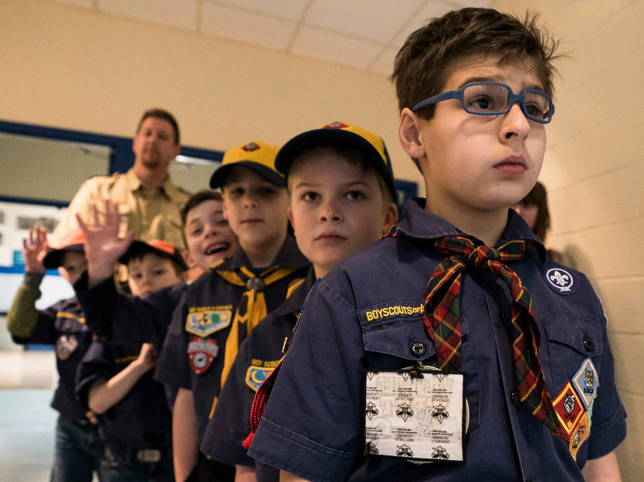 Right, Cub Scout Oliver Levi, 10, gets ready to lead Pack 620 into the auditorium at Mount Mansfield Union High School in Jericho on Tuesday, March 5, 2019, for the pledge of allegiance to start Town Meeting Day.