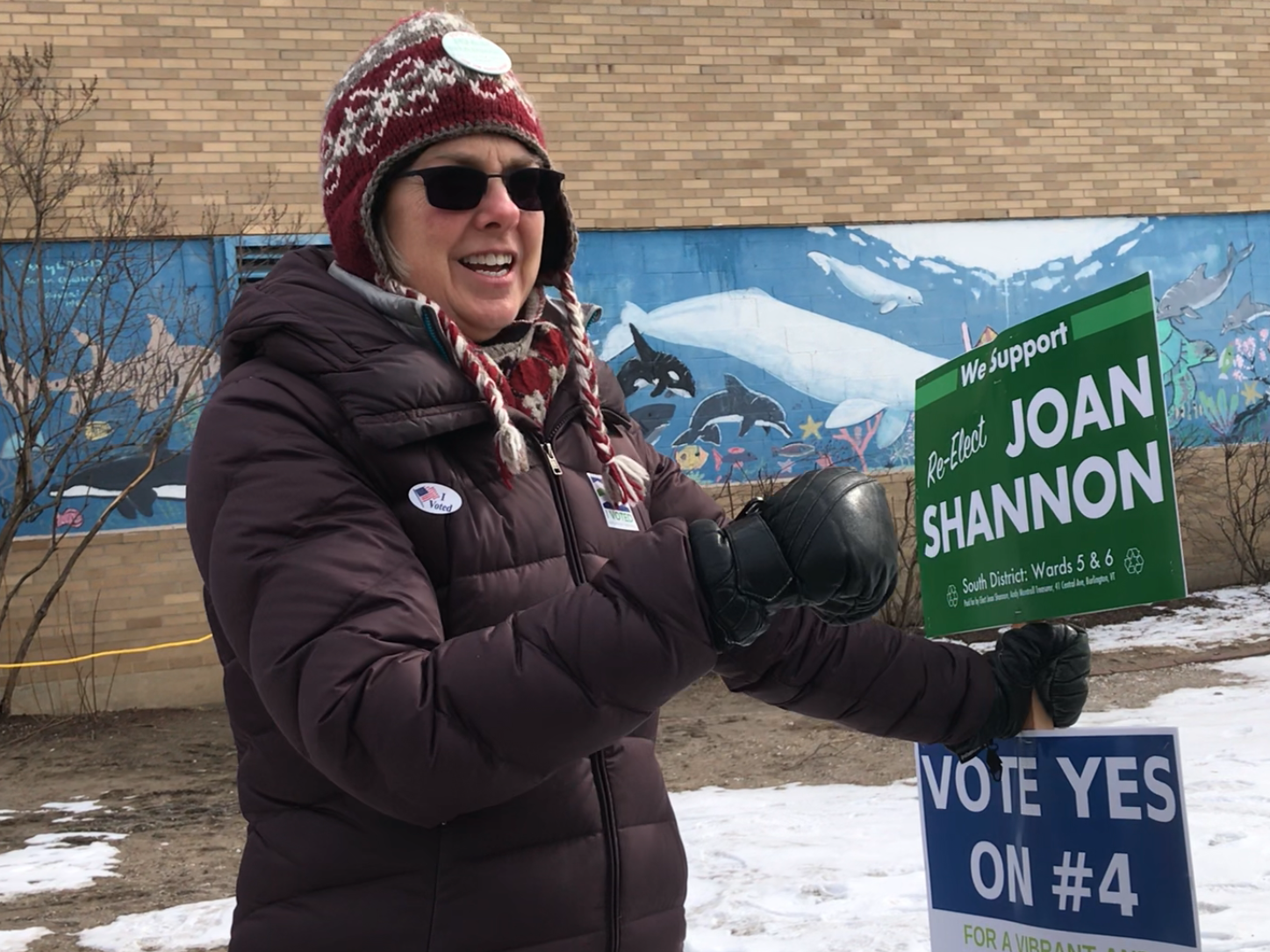 Joan Shannon, Burlington City Councilor for the South District, speaks with a voter outside the polls at Edmunds Elementary School on Tuesday, March 5, 2019.