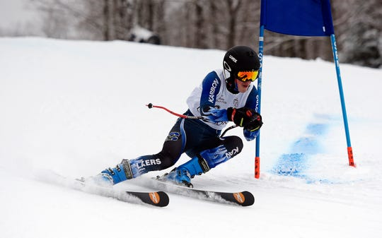 Colchester's David Mansfield-Allesio competes in the Vermont boys' giant slalom championship at Burke Mountain on Monday, March 4, 2019.